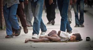 A Nepalese street child sleeps on Thamel street